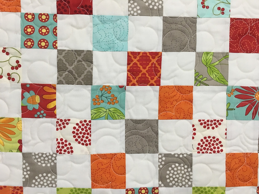 Another closeup of flowers quilting pattern on Postage Stamp Quilt by Karen Hollensbe