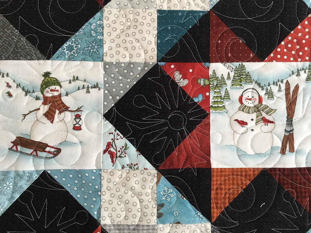 Snowflake Quilting Pattern on Snow Days quilt by Leslie St.Onge