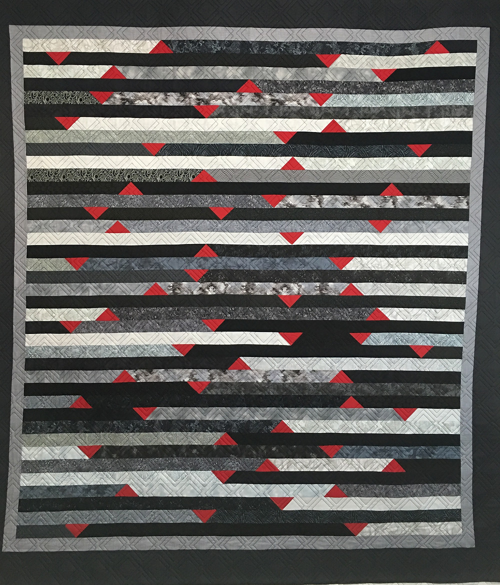 Jelly Roll Race Quilt made by Sally Krebs