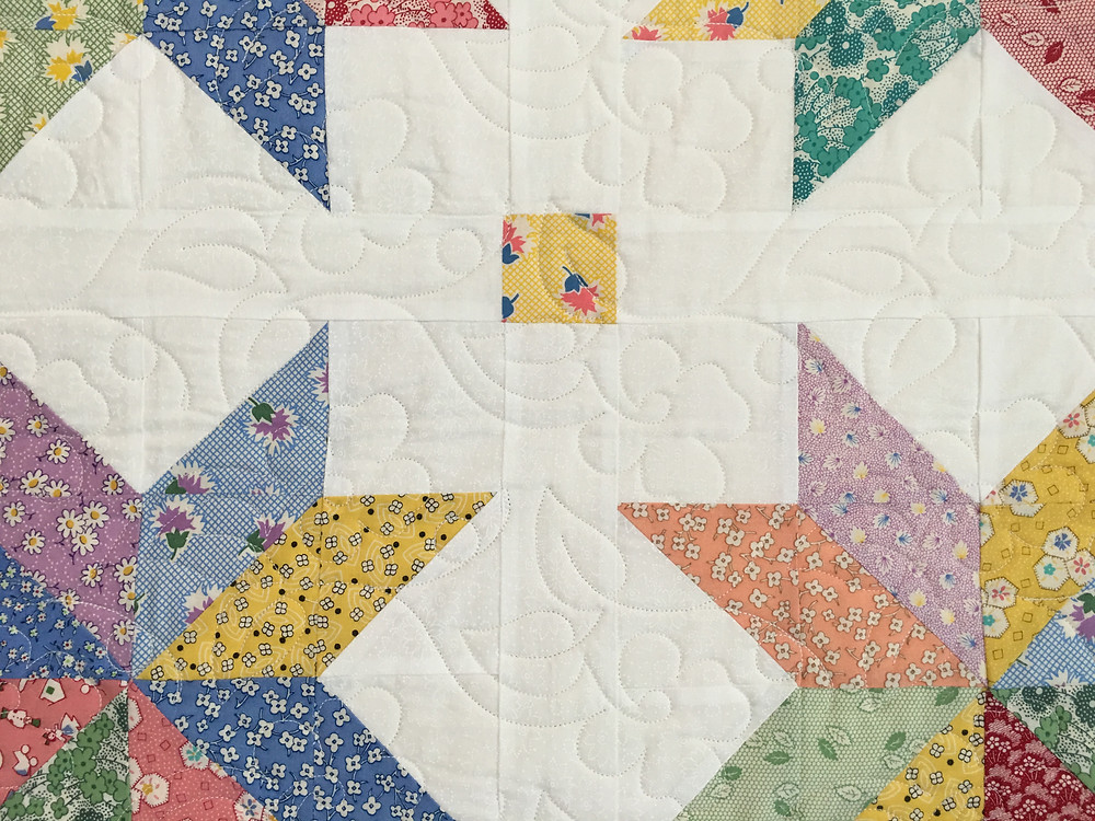Flower quilting design on Ohio Star quilt by Andi Hays