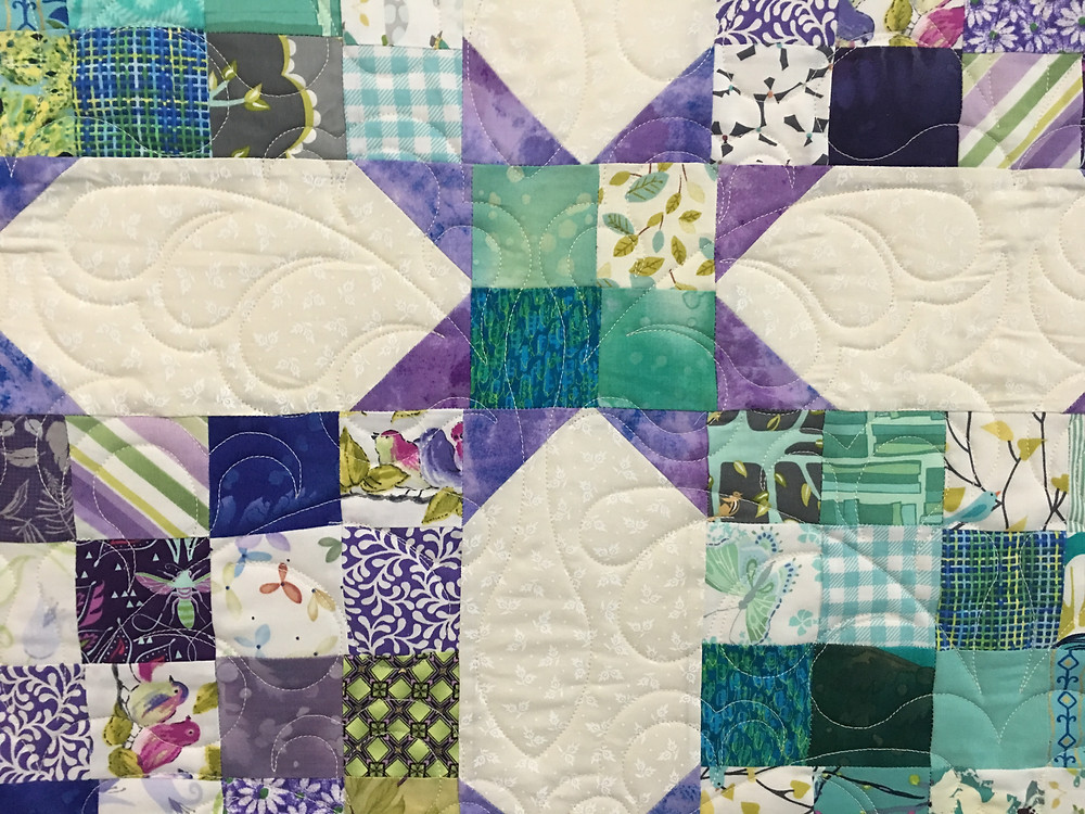 Feather Quilting Pattern on Double Four Patch Snowball Quilt by Judi Castro
