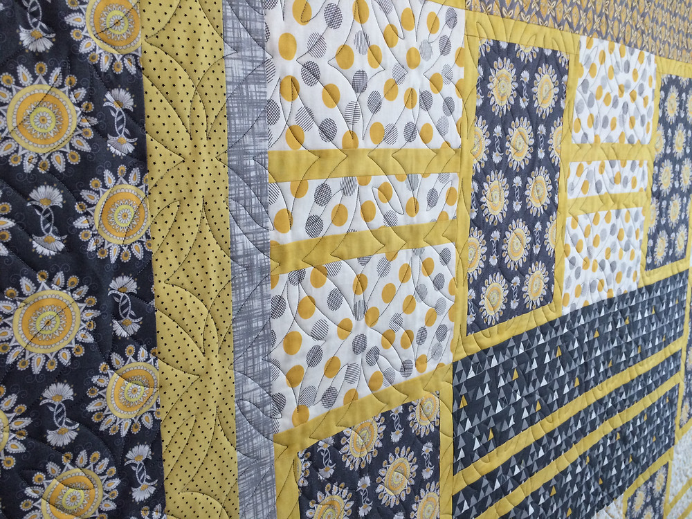artistic photo of blue and yellow quilt