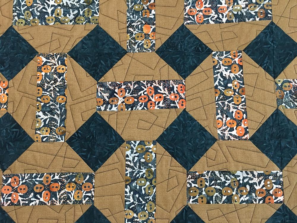 Geometric quilting pattern on Teal Batiks quilt by Jill Seward