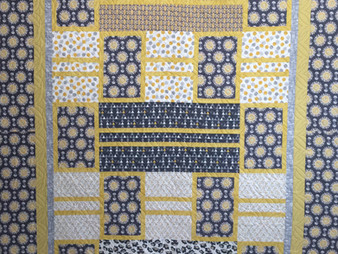 Cheryl Cohorn Blue and Yellow Quilt