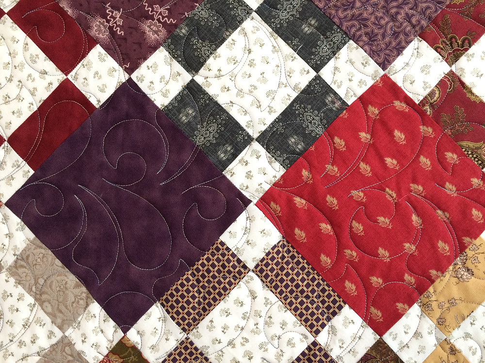 close up of Jean Tucker 2nd Hand Clothes Quilt