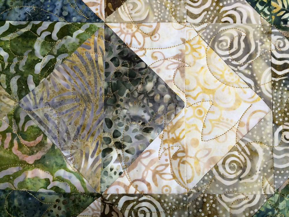 closeup of Cynthia Parra's green and brown batiks quilt
