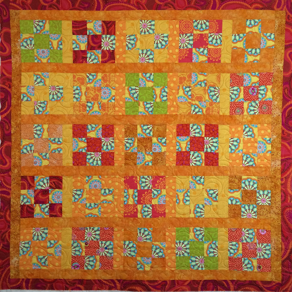 Nancy Thornton Kaffe Fassett Orange Yellow and red quilt