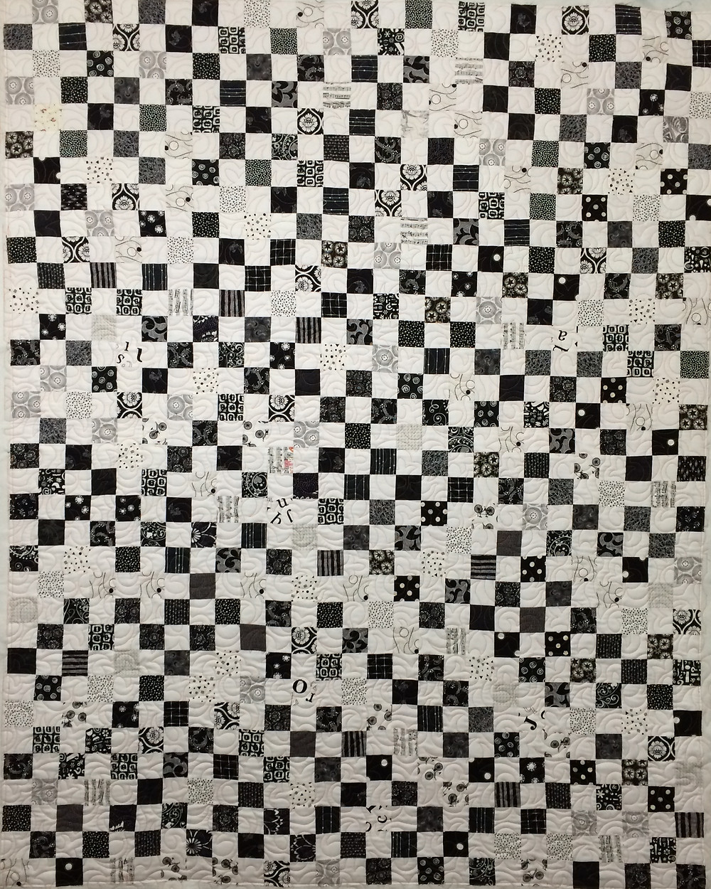 black and white quilt with small squares