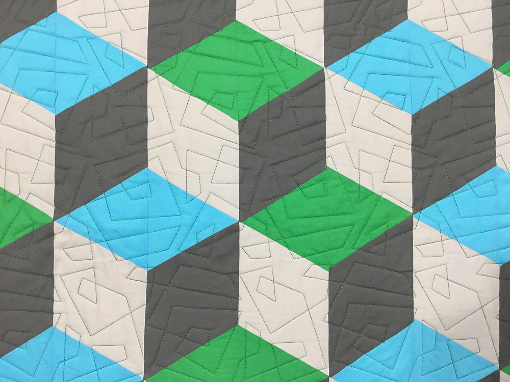 Geometric quilting pattern on Rhombus Quilt by Cindy Lovelace