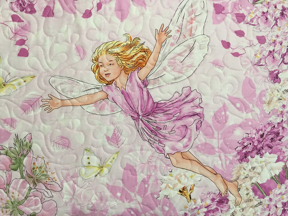 Closeup of Fairy dancing in the wind quilt