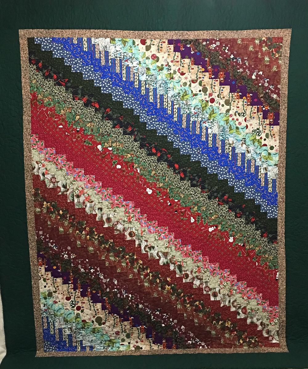 Quick quarter trip around the world quilt by Elsa Murray