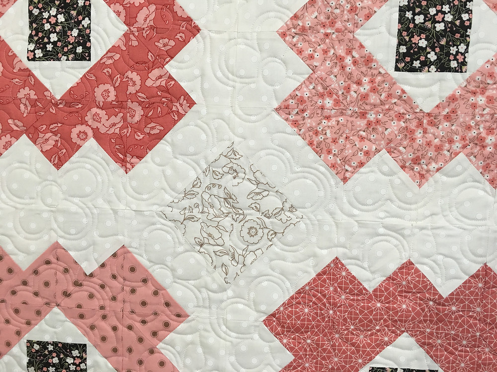 close up of Sarah Daisy Quilt in Shades of Pink
