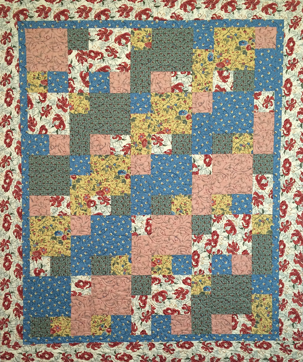 Toni Red Flowers with yellow and blue blocks quilt