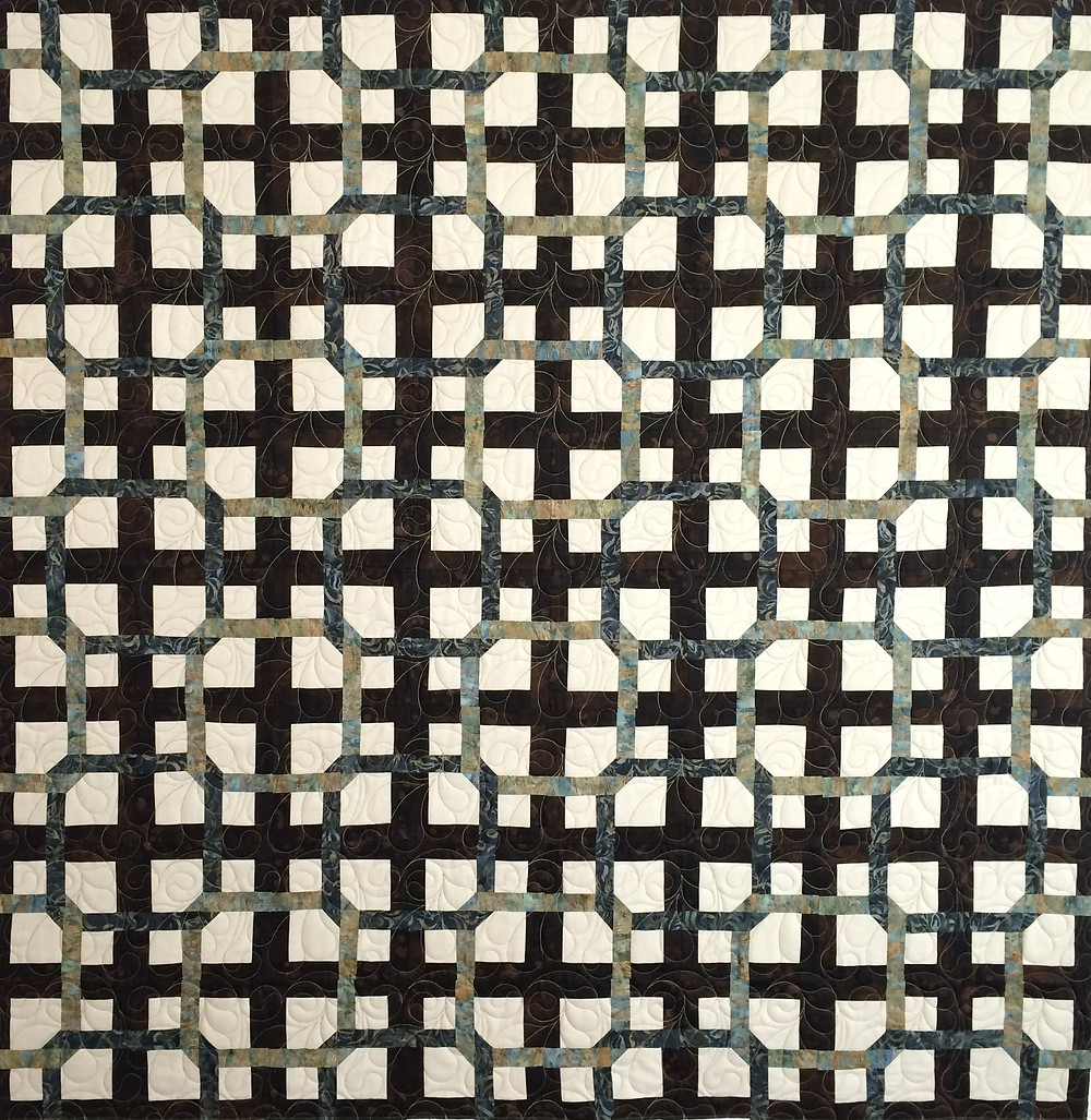 repeating block quilt in shades of gray