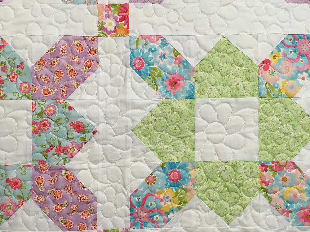 closeup of Mary Derryberry Prairie Flower Quilt
