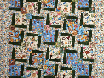 Leslie St.Onge Birds and Butterflies Quilt