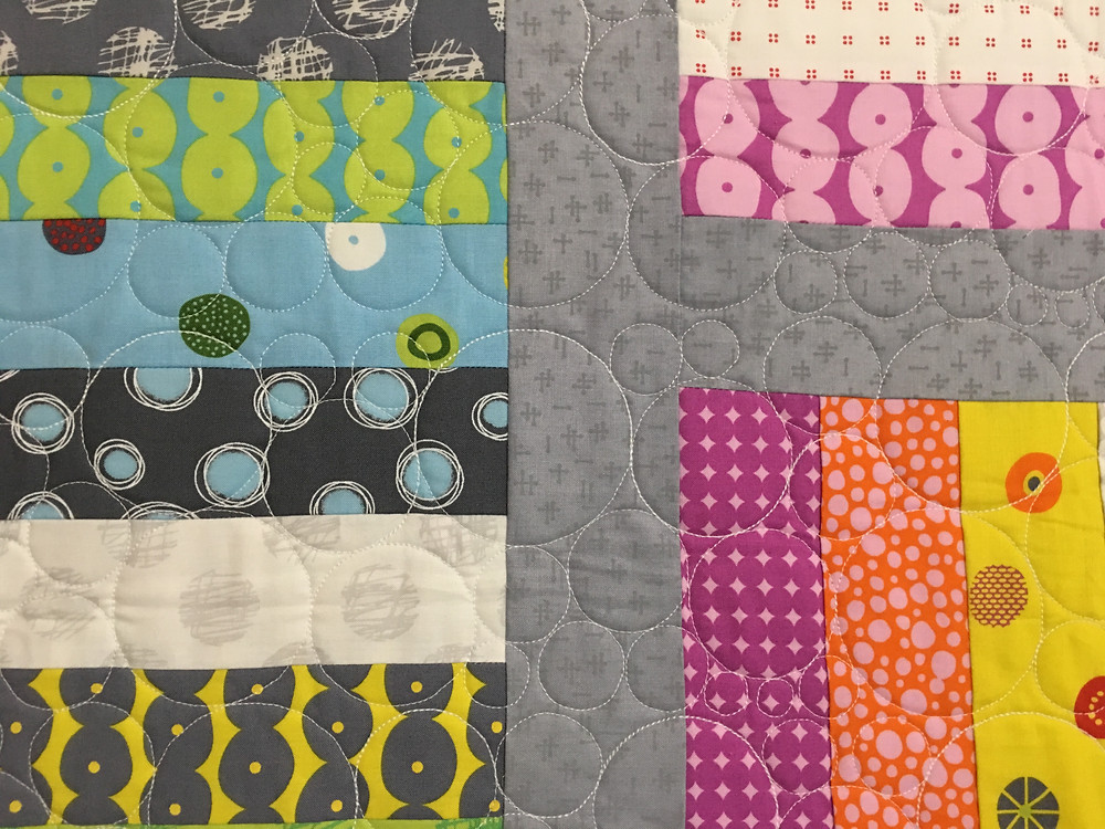 Circles quilting pattern on Jelly Roll quilt for Grandbaby