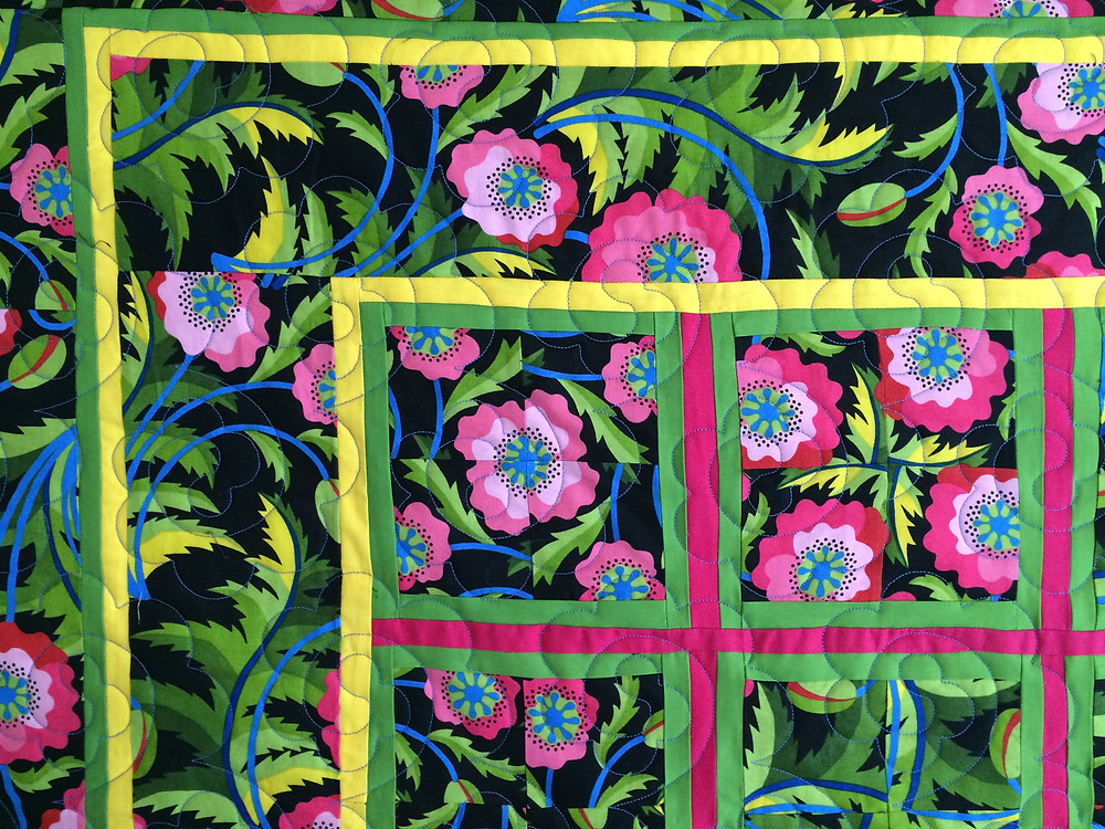 corner of stack and wack quilt with large floral prints