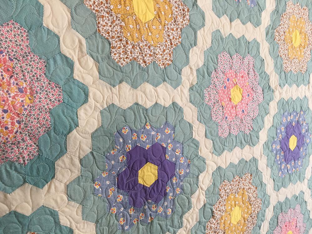 closeup of hexagon quilt by Dyanna Eastwood