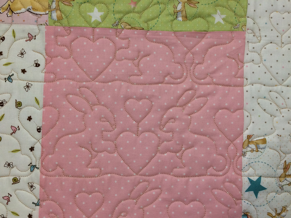 Close up of Sandra Rishell Bunny Baby Quilt
