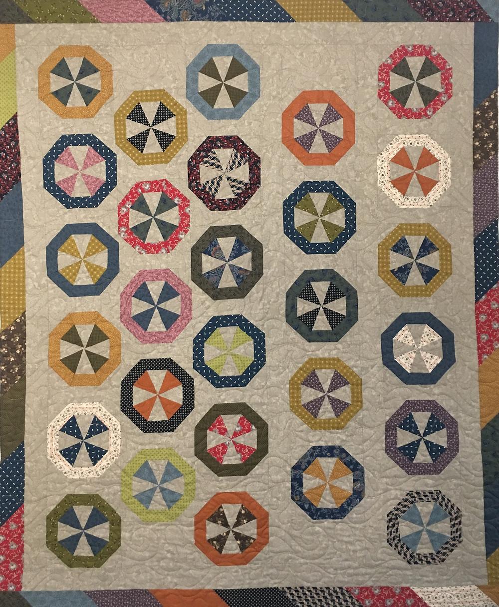 Scrappy Pinwheel Hedgehog Block Quilt by Jill Seward