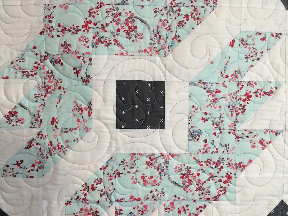 closeup of quilting desing of swirls on Codi Wonderland Quilt