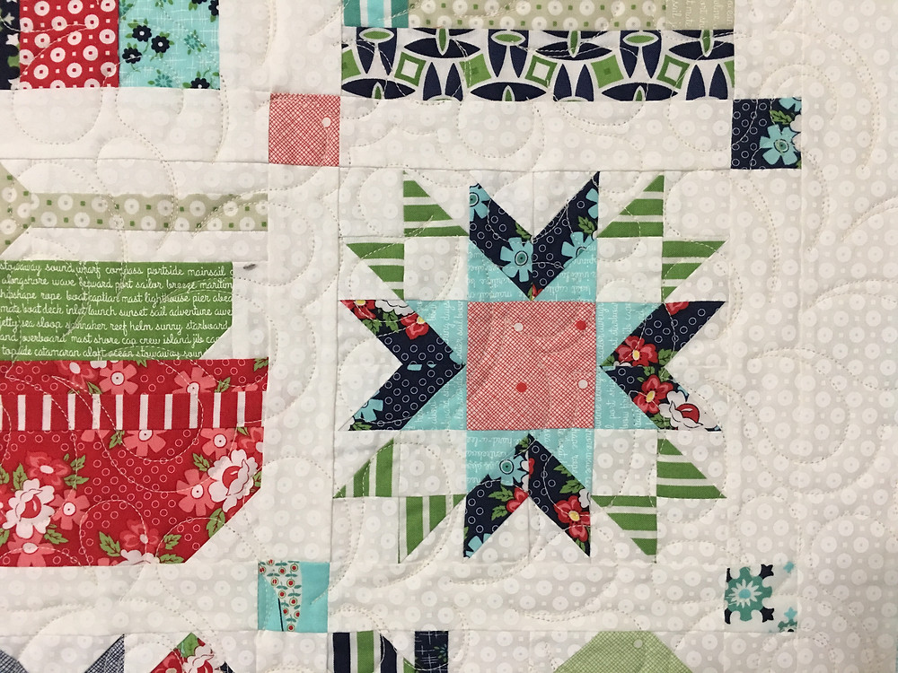 Feather quilting pattern on Farm Girl Vintage Quilt by Deborah Hawkins