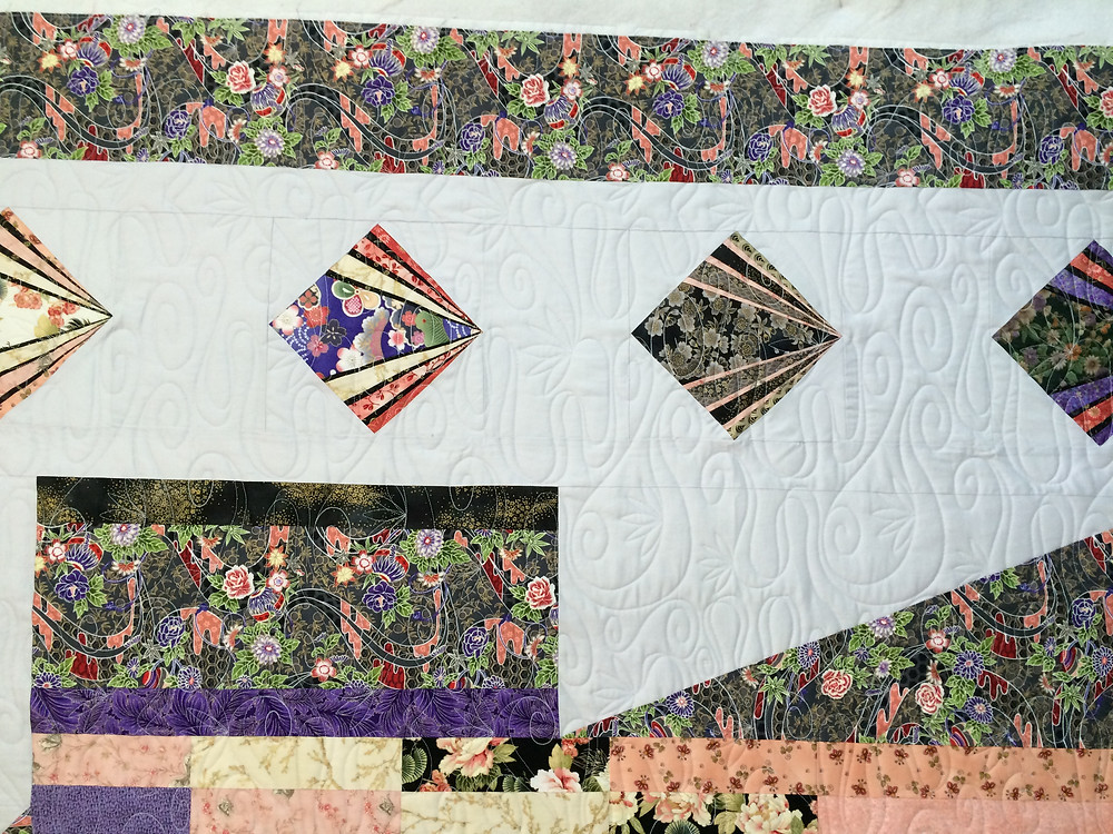 closeup of Kimono quilt in lovely oriental fabrics