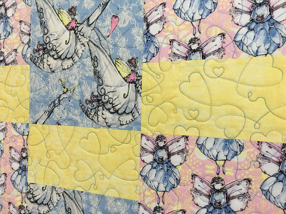 Hearts quilting pattern on Little Angels Quilt by Nancy Nesbaum
