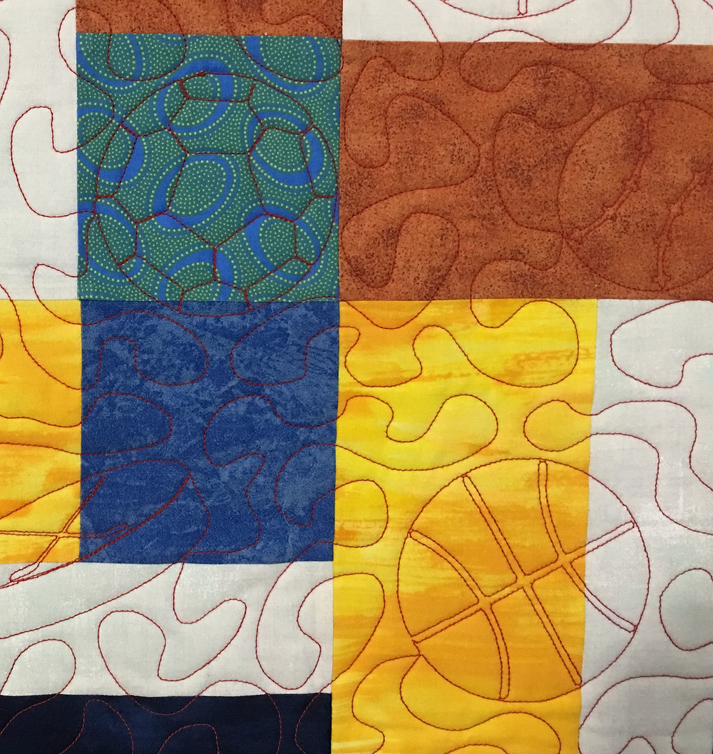 Can you see the soccer ball and baseball in the quilting pattern