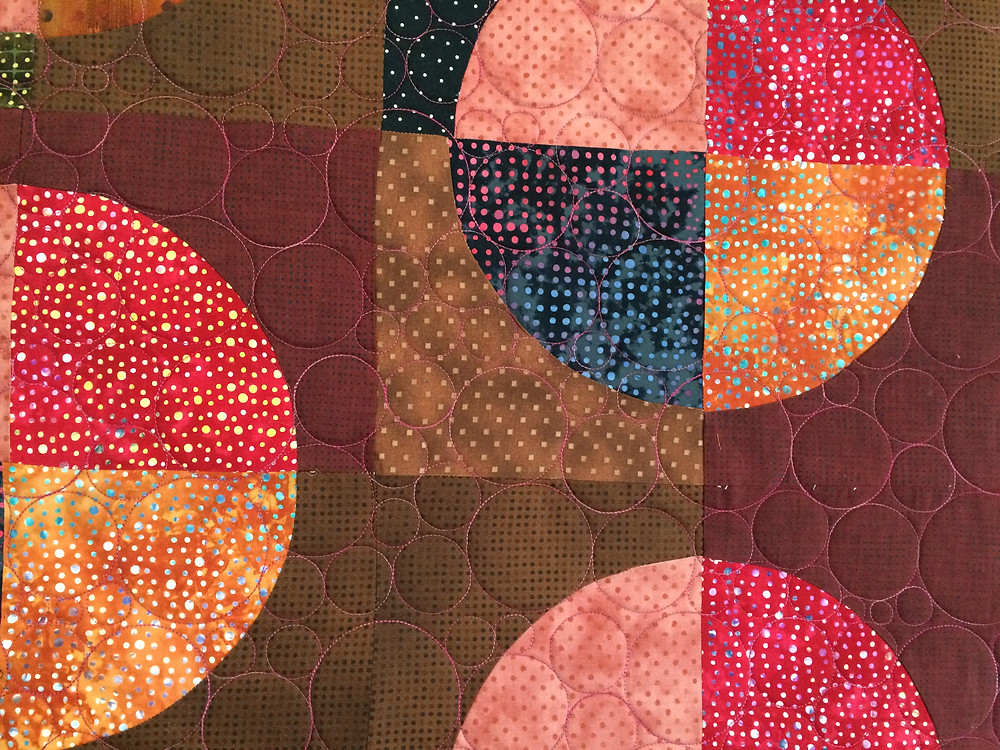 Closeup of Sue Antle Floating Circles Quilt