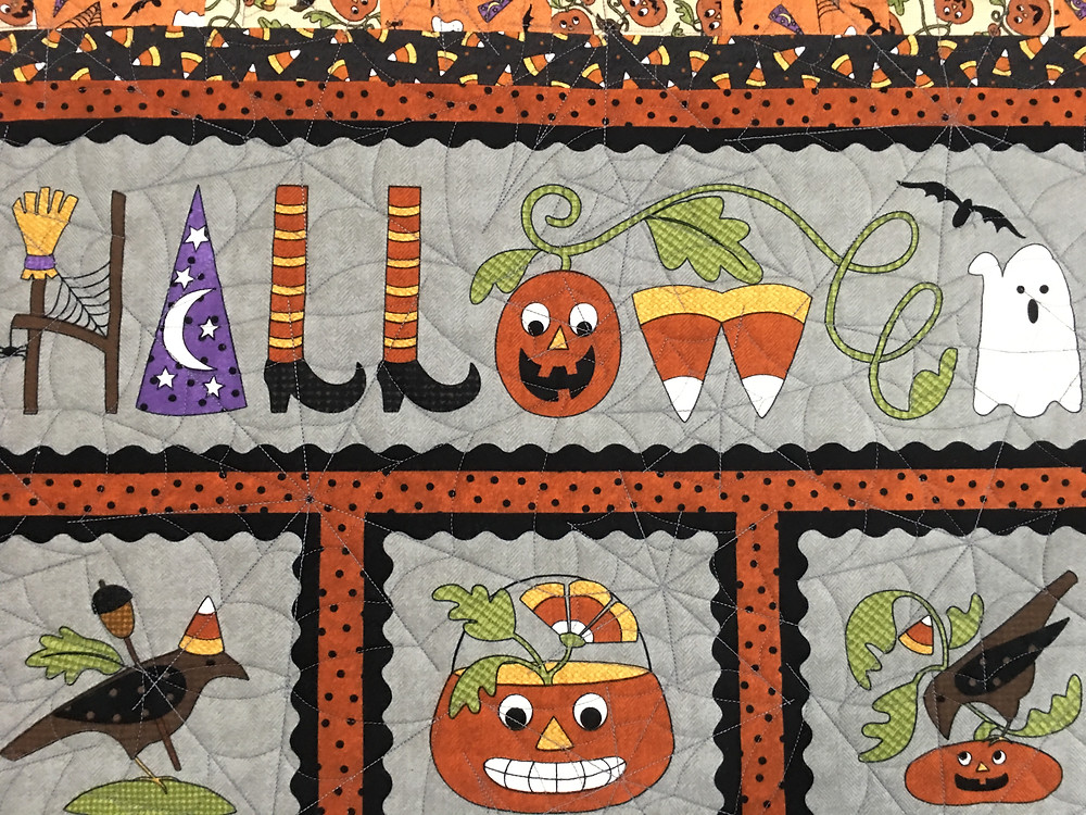 Spider Web Quilting pattern on Halloween Quilt by Leslie St.Onge
