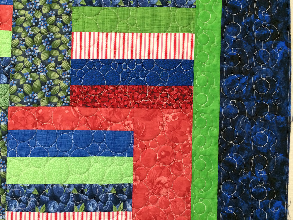 Circles Quilting Pattern on Jelly Roll quilt by Lori Becker