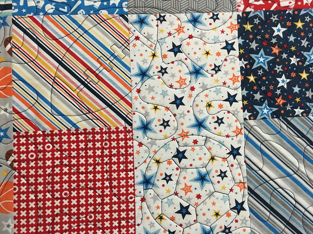 Football and Soccer quilting pattern on Jelly Roll Sports Theme Quilt by Delfina Guerra