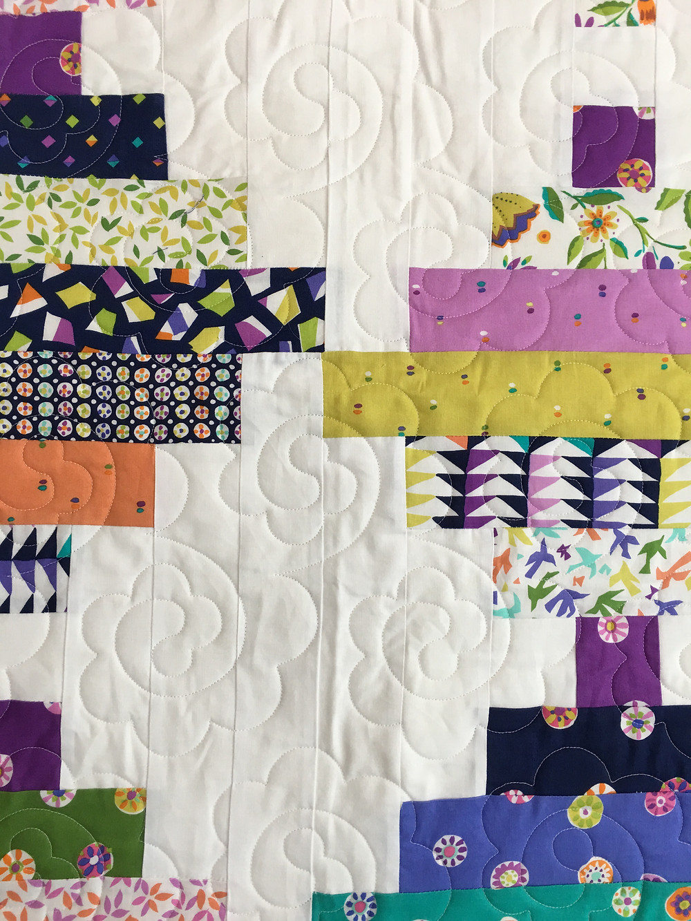 Floral Quilting Pattern on Courthouse Steps Quilt by Bella Malis