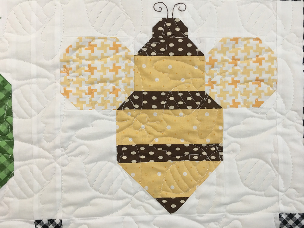 Close up of Bumble Bee Quilting Pattern on Vegetable Quilt by Deb Taylor