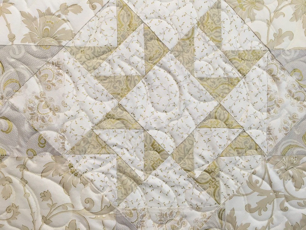 close up of Penny Downtown Abbey Quilt in soft tones