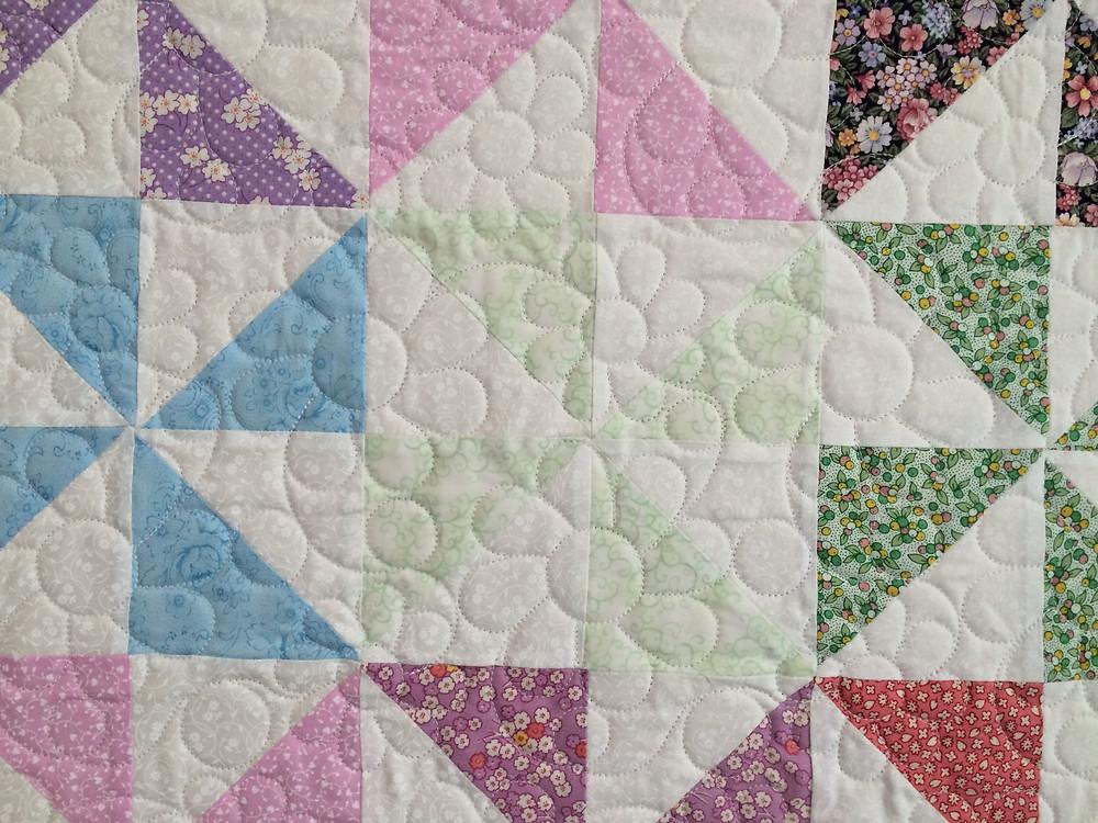Closeup of Joanne Kozlowsky Pinwheel Quilt