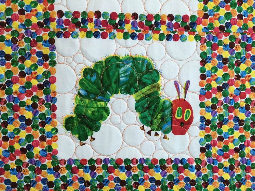 close up of caterpillar quilt block