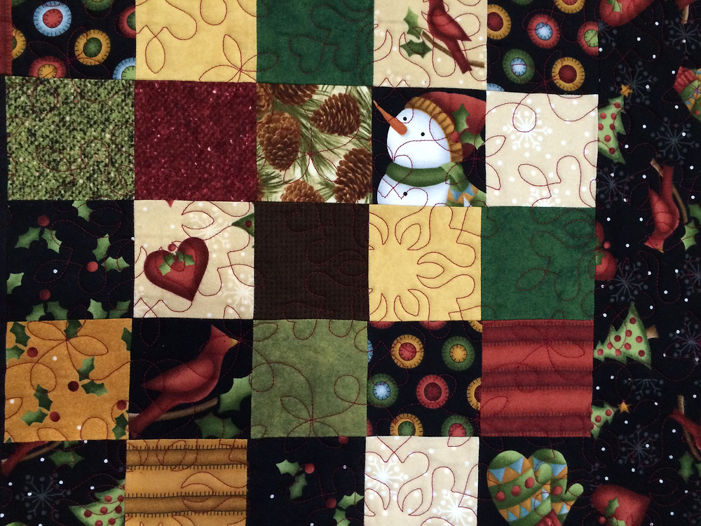 close up of Leslie St. Onge Holiday Quilt