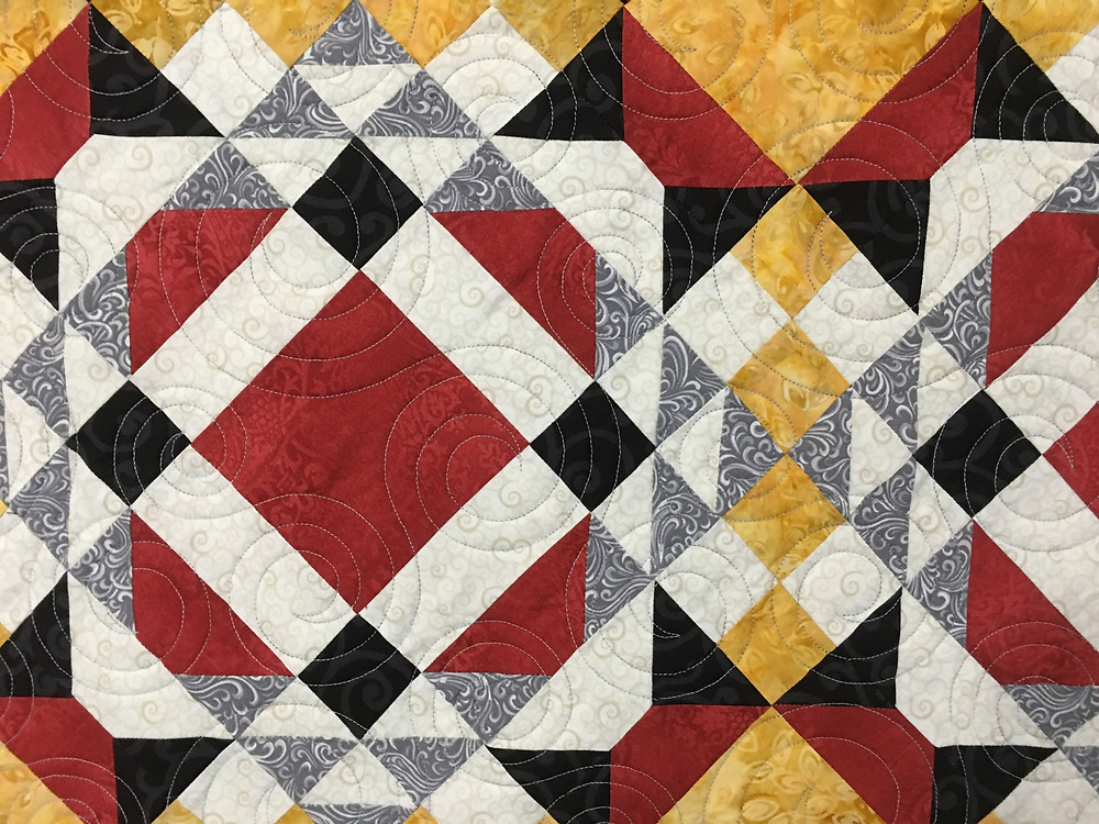 Circles Quilting Patterns on Stars and Diamonds Quilt by Linda Betncourt