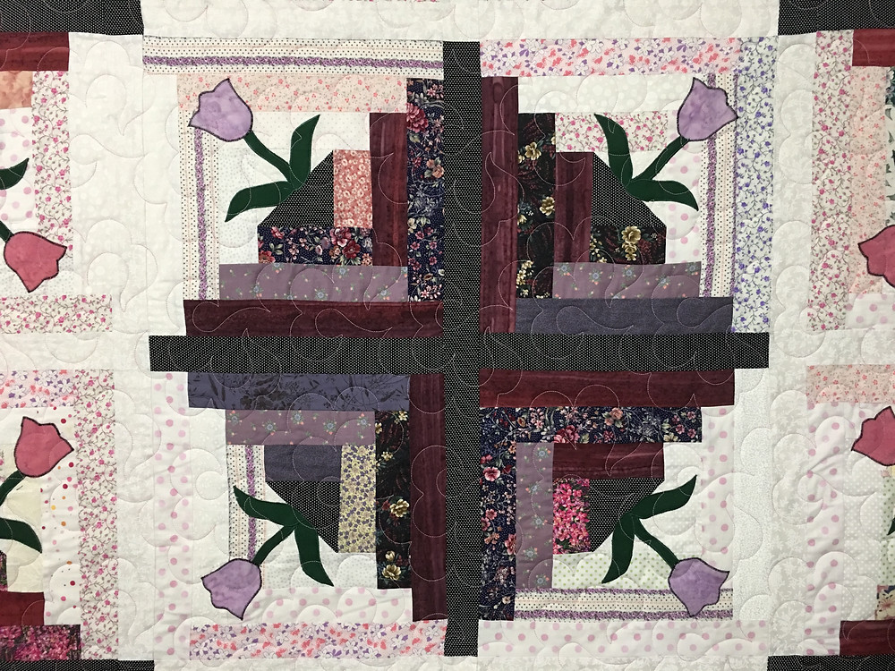 Center of Log Cabin with Tulips Quilt by Dolores Steward