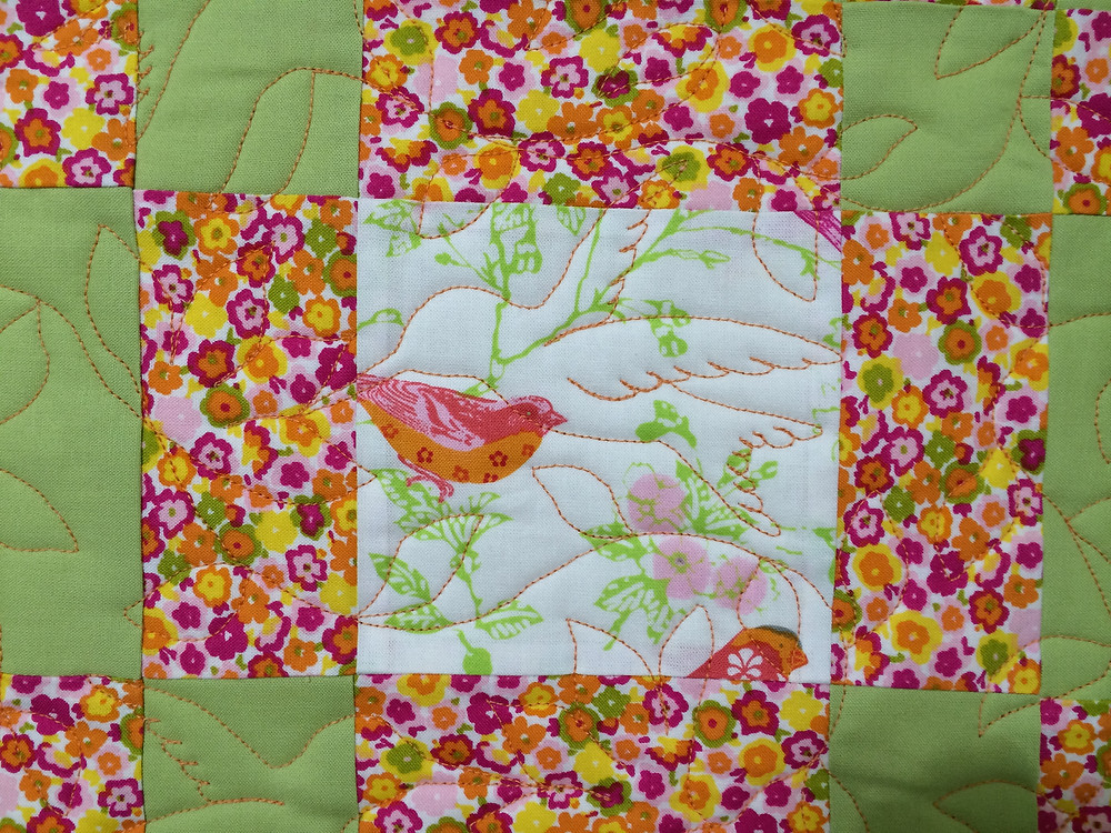 closeup of humming bird quilting design