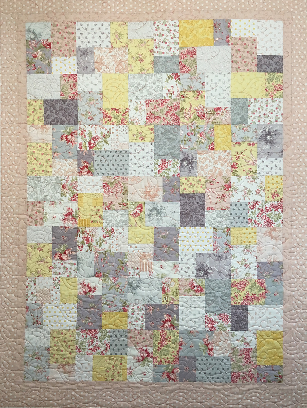 Sharon Gregorczyk Layer Cake Quilt in pastels.
