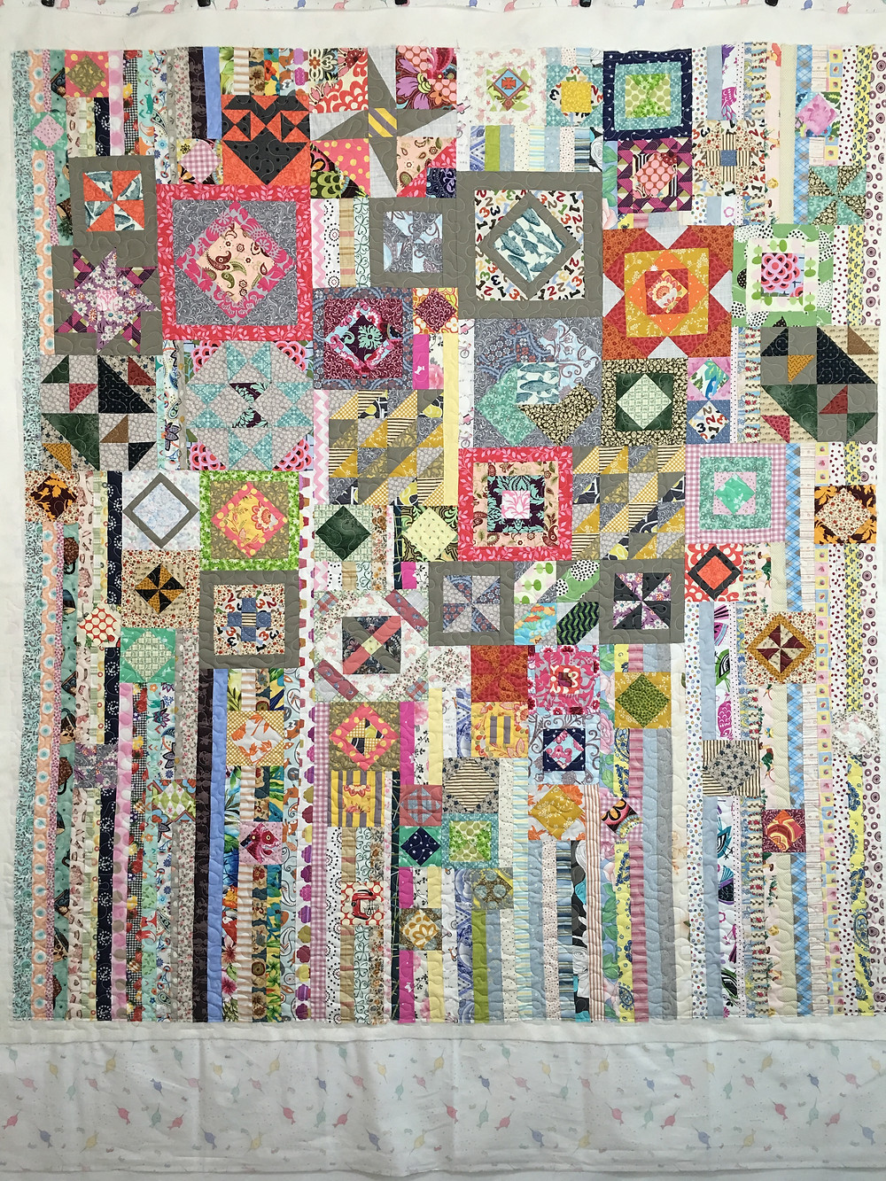 Julianna's scrappy, modern gypsy quilt in a variety of fabrics and blocks