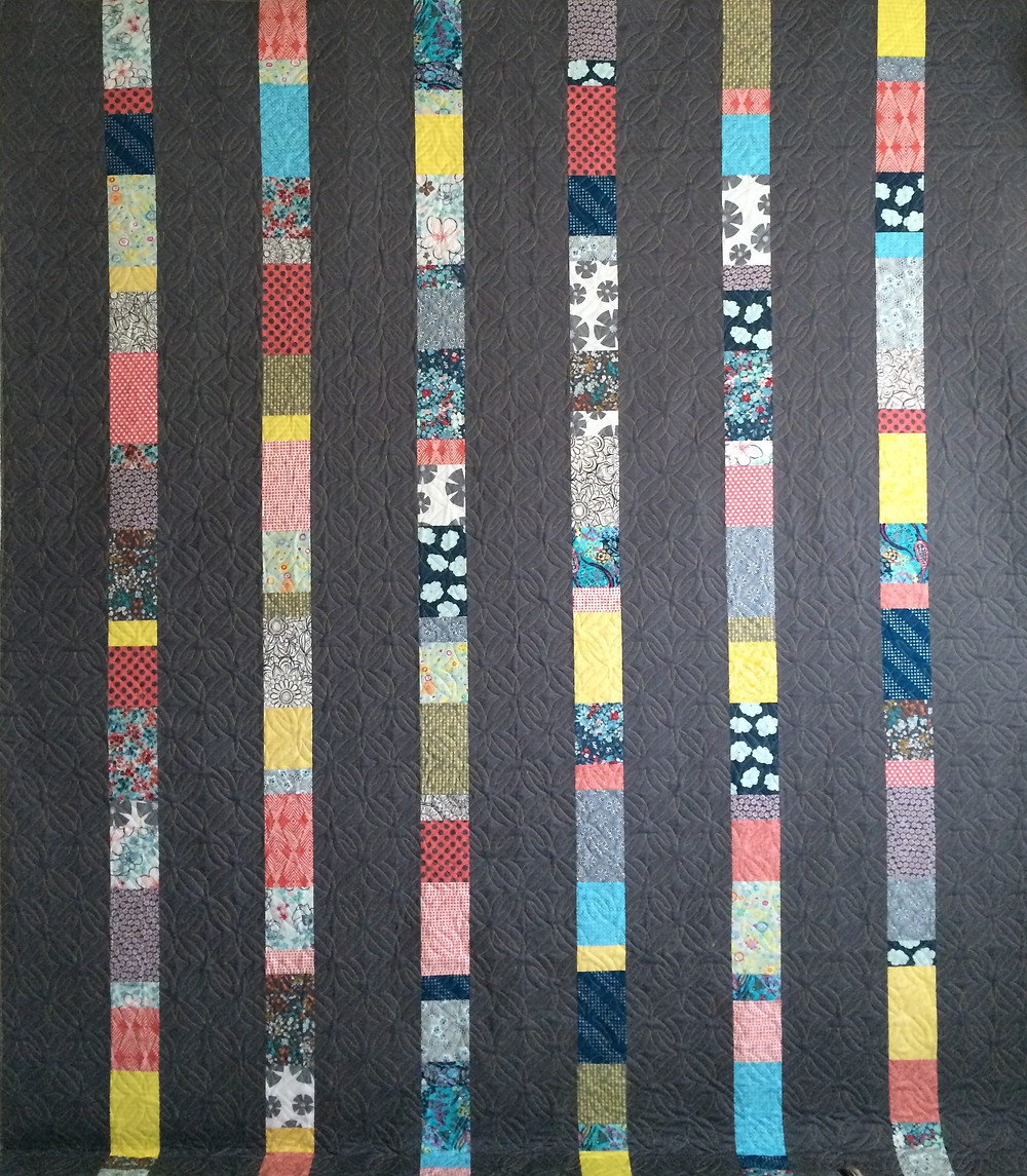Vertical Strip quilt in black and stripes of multi colors