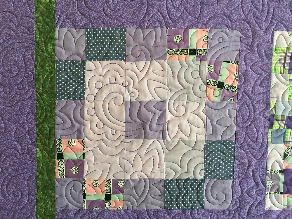 Flower quilting Pattern on Sampler in Lavender Quilt by Valarie Sherriff