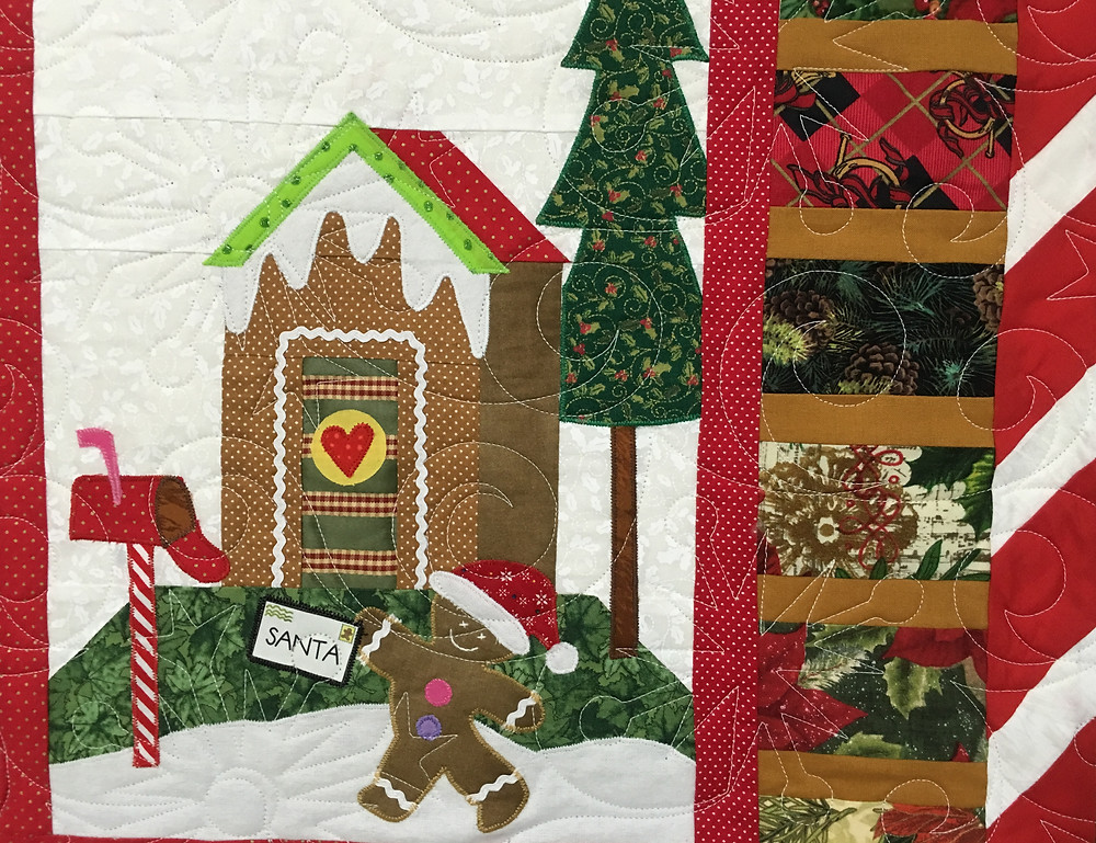 Snowflake quilting pattern on Gingerbread Village Quilt by Liz Zoch