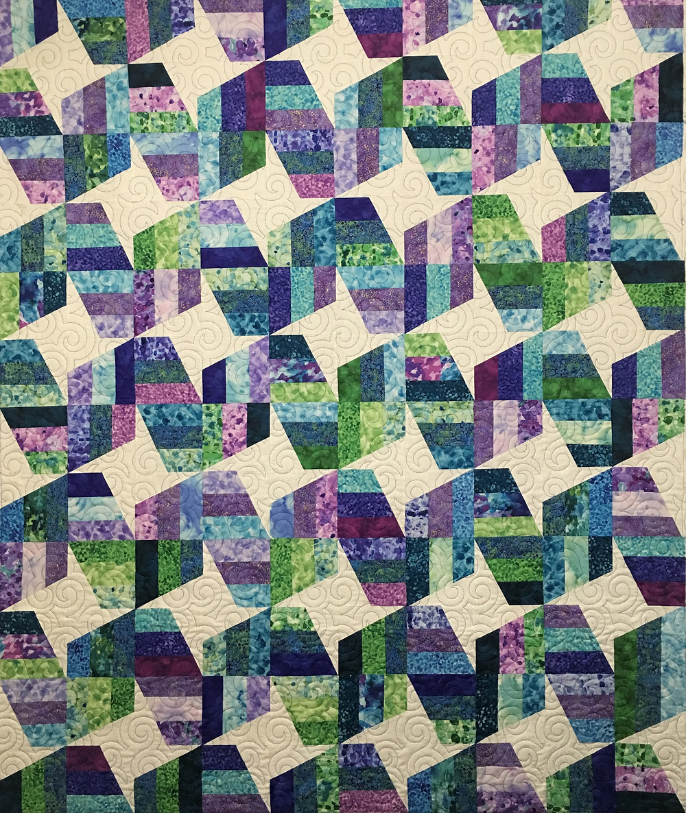 Cindy Unwind Quilt in shades of purples