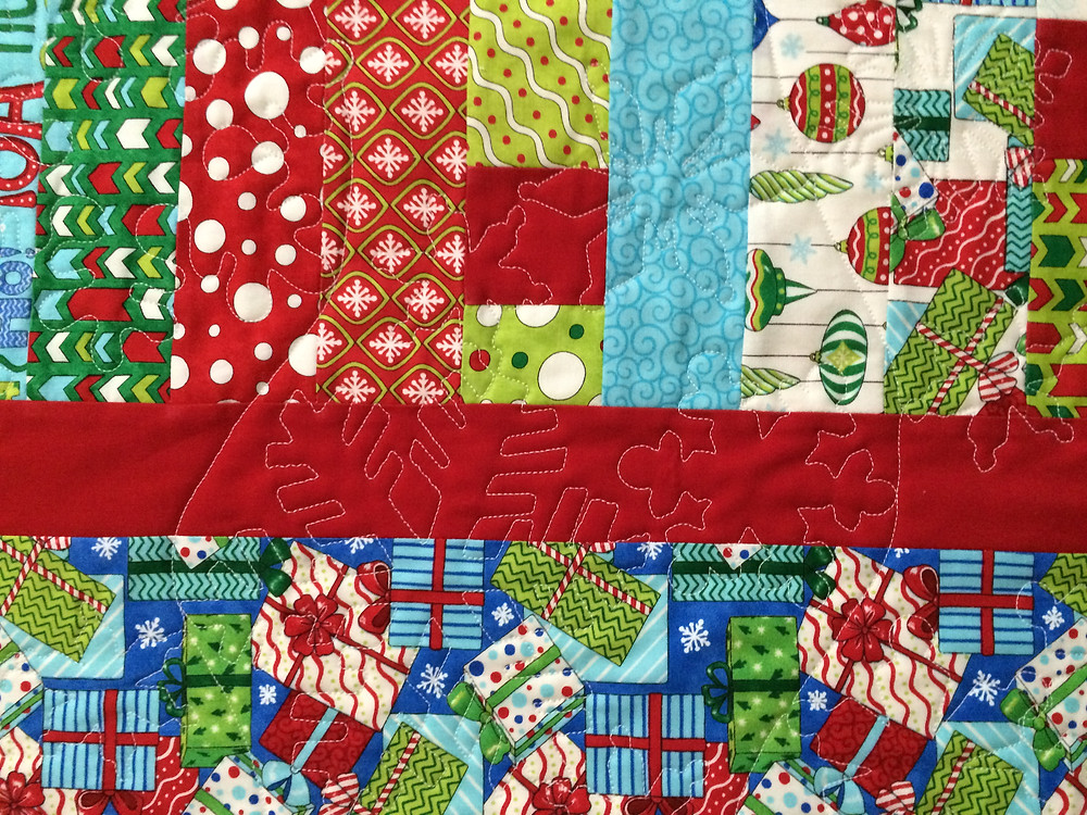 close up of Delfina Guerra Christmas Jelly Roll Quilt